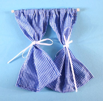 Pair Of Blue Gingham Curtains On Pole